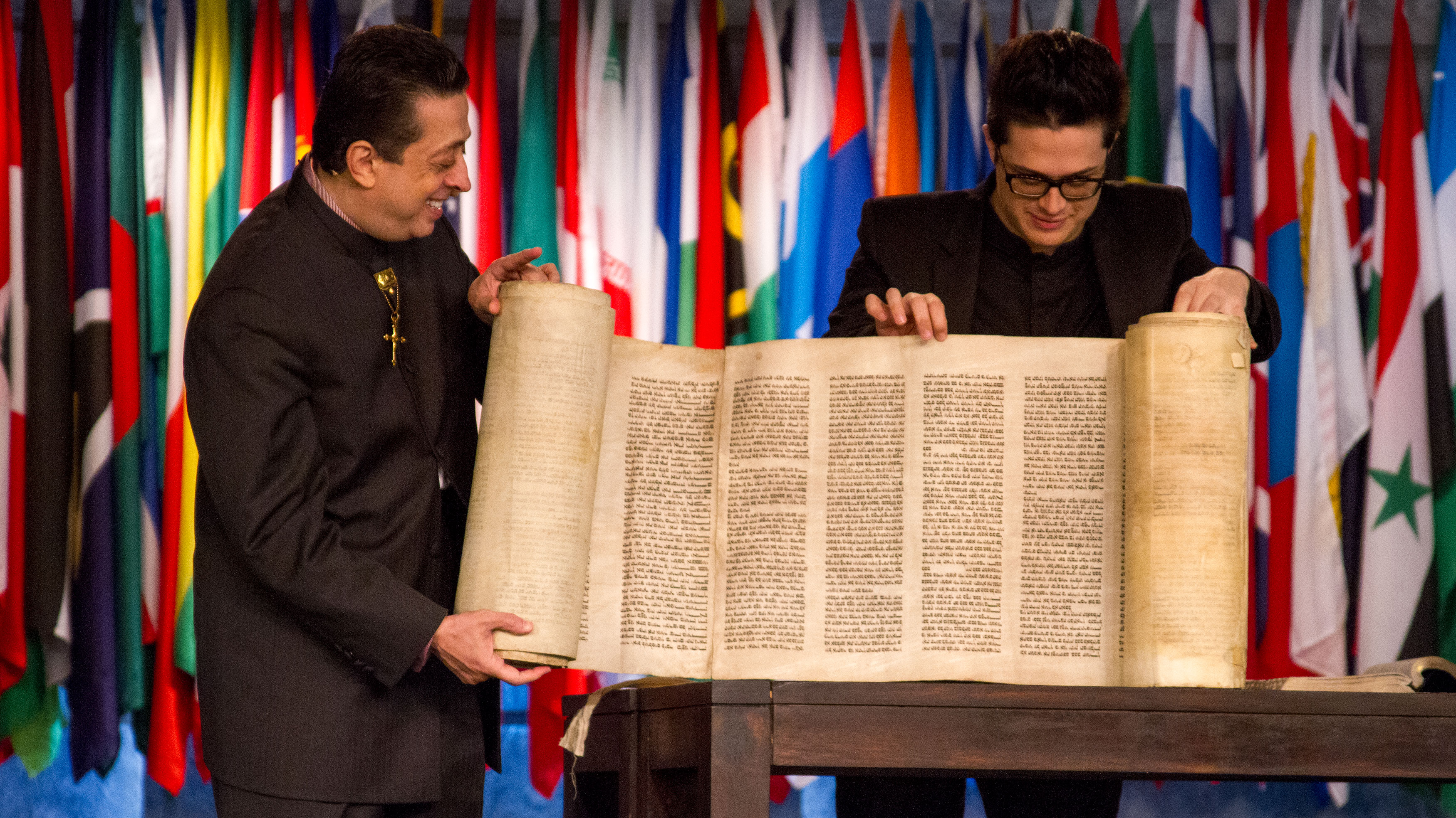 Apostle Doctor Christian Harfouche and Rev. John Harfouche showing a 250 year old, Holocaust-survivor Torah.